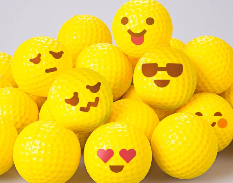 Yellow emoji golf balls