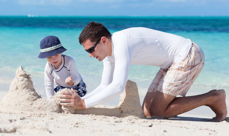 Designer_at_beach_with_child