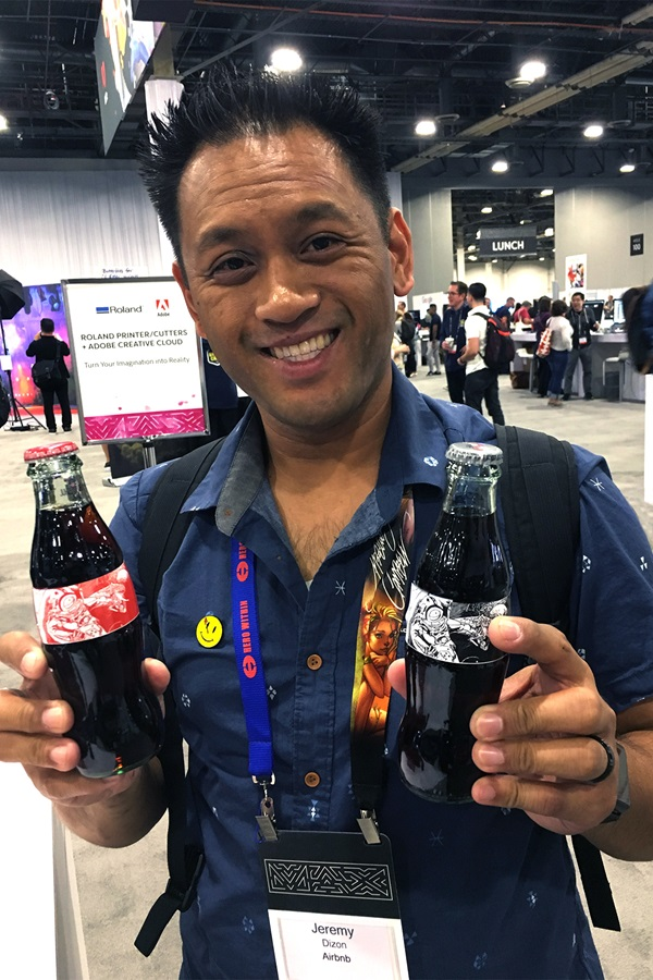 Adobe MAX conference attendee Jeremy Dixon shows off his customized Coke labels printed on a Roland VG series printer cutter