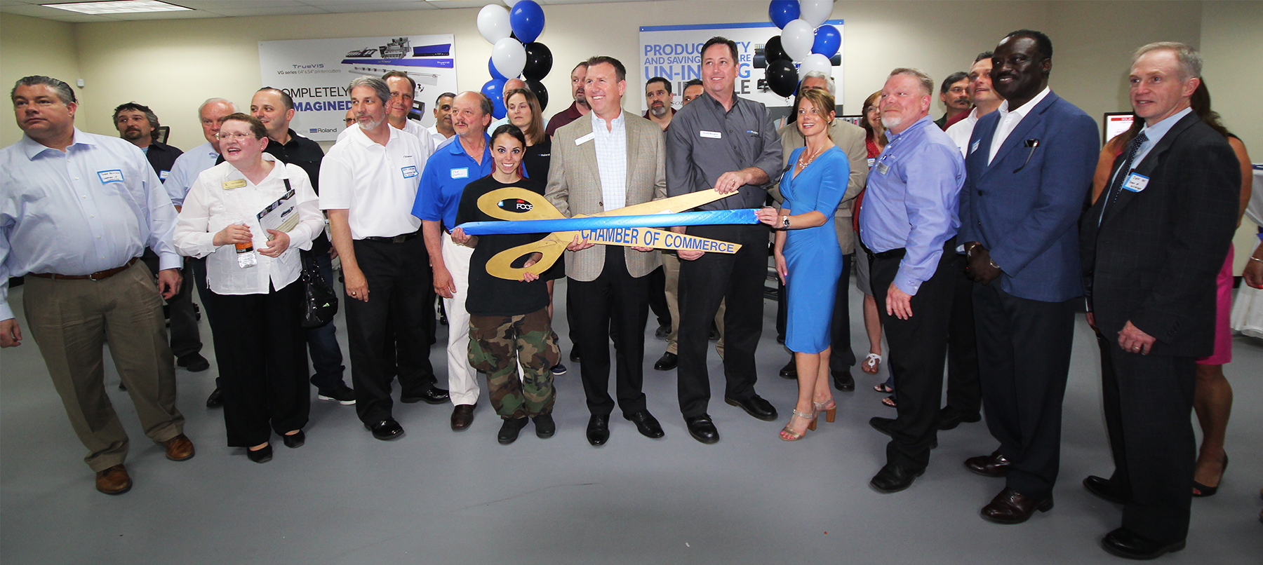 Ribbon-cutting ceremony at Grand Opening ceremony for Roland DGA's new East Coast Imagination Center