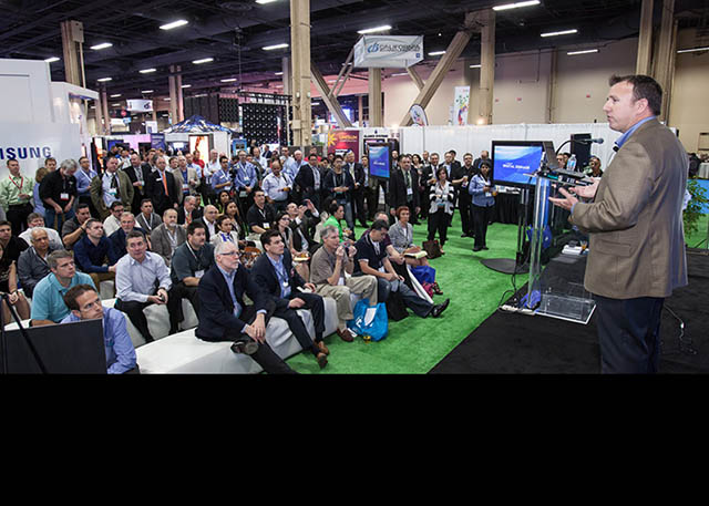 2013 New Roland DGA president, Rick Scrimger, announces at the International Sign Expo, a Roland digital signage solution that will help demystify digital signage for traditional sign shops.