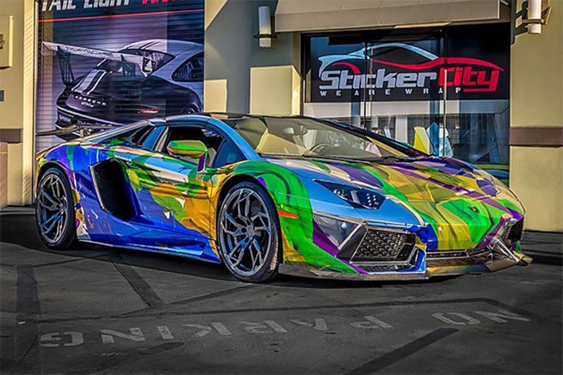 StickerCity of Sherman Oaks, California. Holographic, multi-color vehicle wrap of Lamborghini Aventador Roadster using Roland SOLJET XR-640