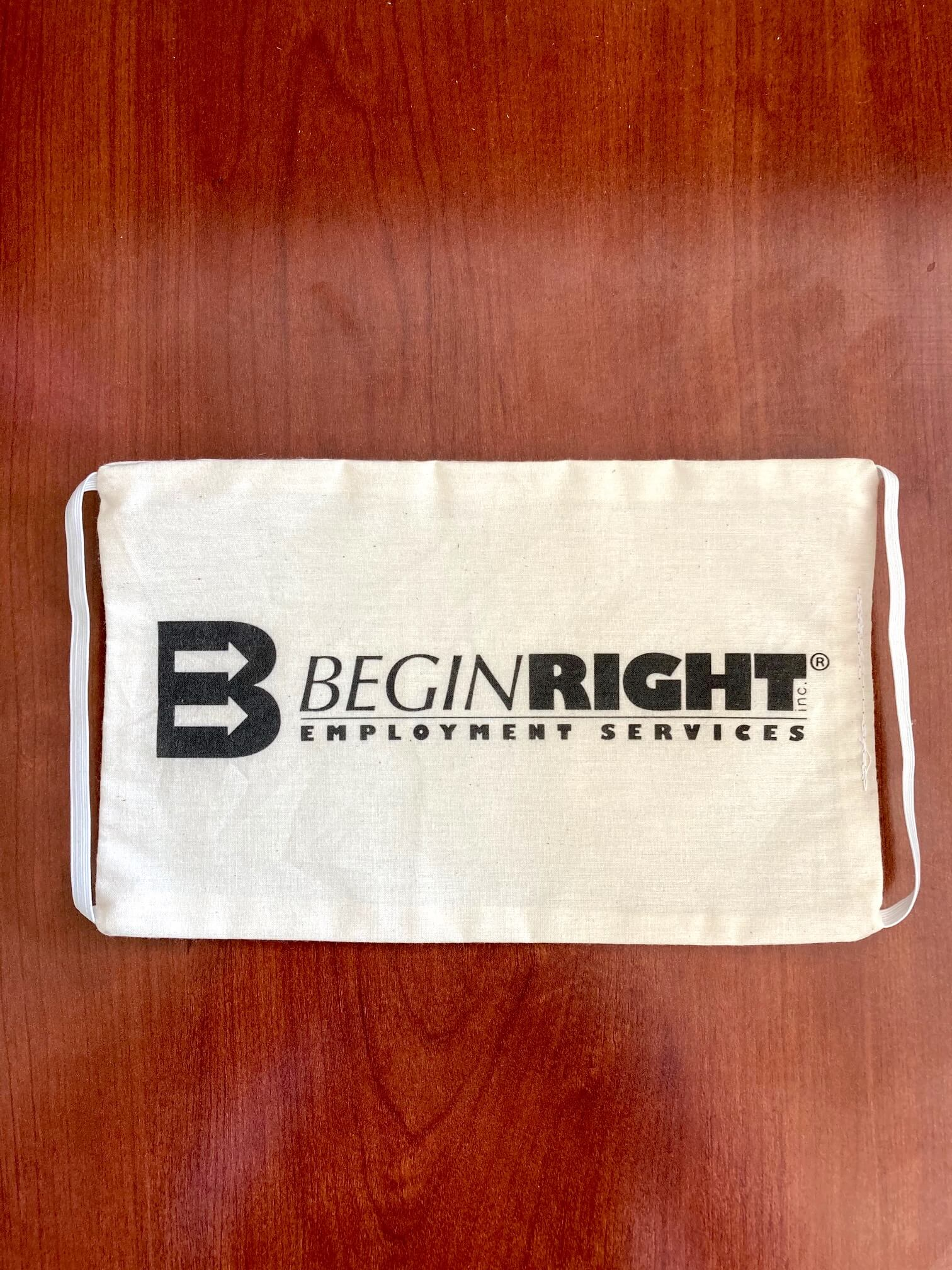 BeginRight Employment Services used its Roland DG BT-12 to print its logo on cloth masks like this one.
