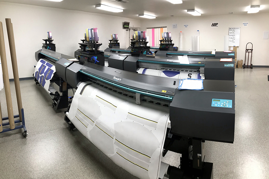 Savi Customs' Roland dye-sublimation printers in action