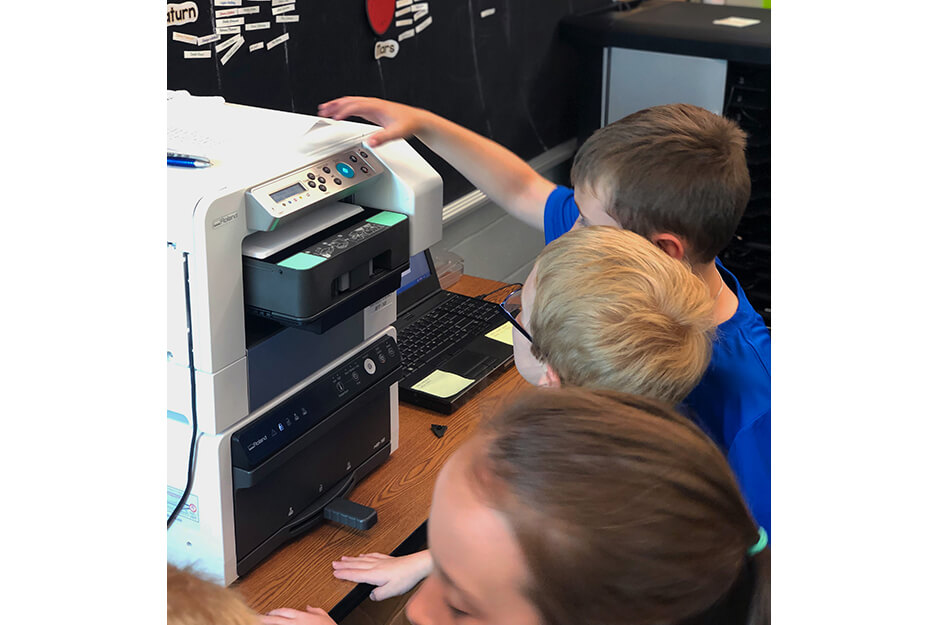 Burrell Elementary students were excited to help make their t-shirts on the Roland BT-12 direct-to-garment printer