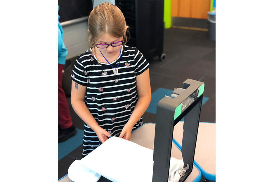 Burrell Elementary students helped print their t-shirts on the easy-to-use Roland BT-12 direct-to-garment printer