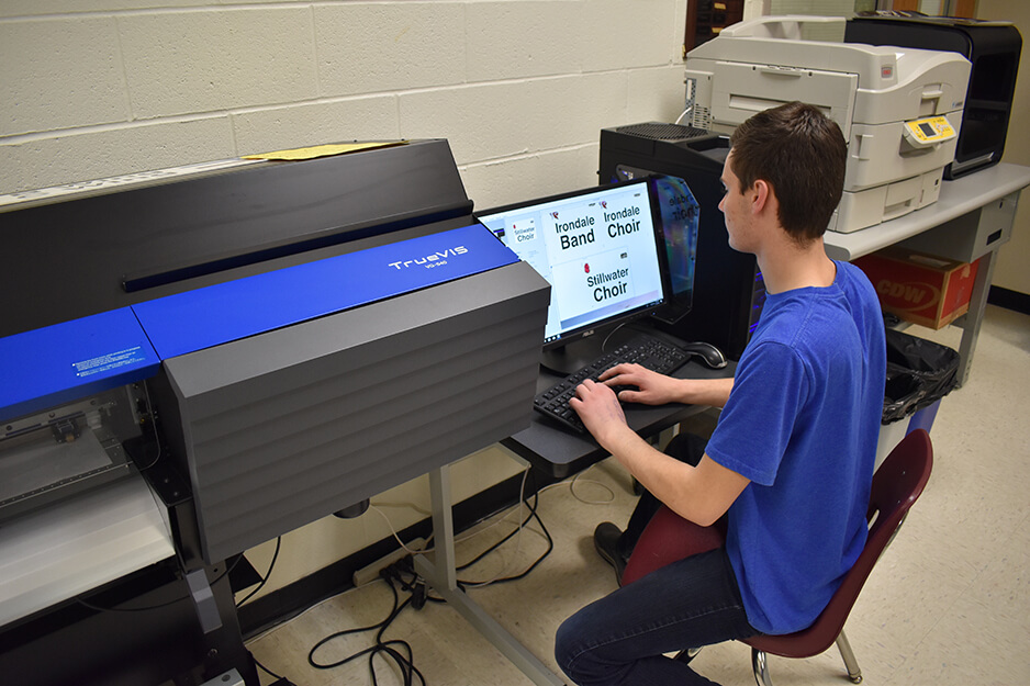 A Roseville student works on designs that will be printed on the Roland TrueVIS VG2 digital printer/cutter