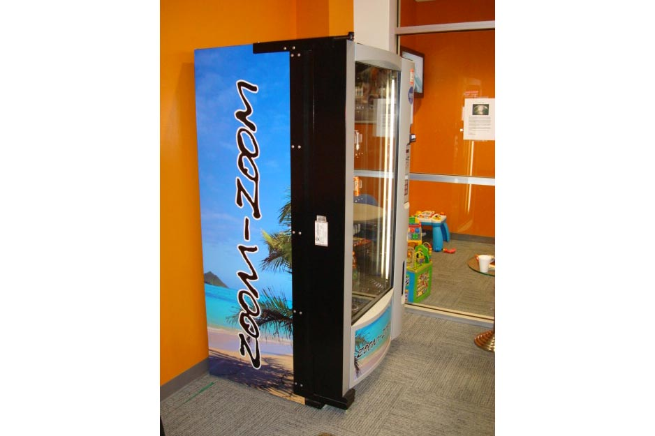 Ocala Auto Graphics VersaCAMM SP vending machine wrap