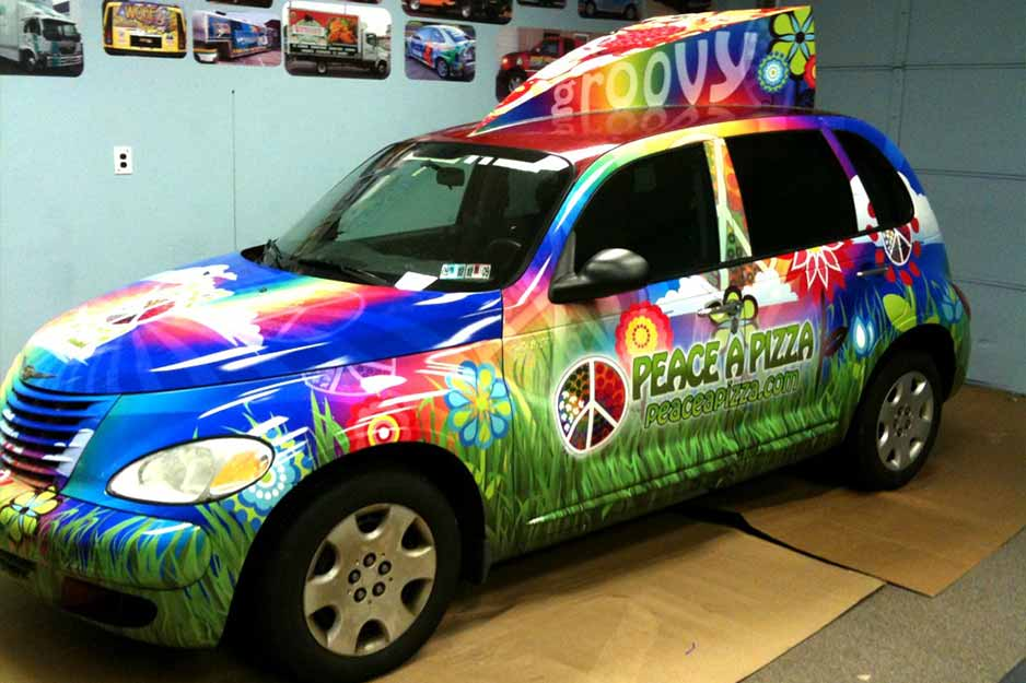 Sunrise Signs VersaCAMM vehicle wrap for Peace A Pizza
