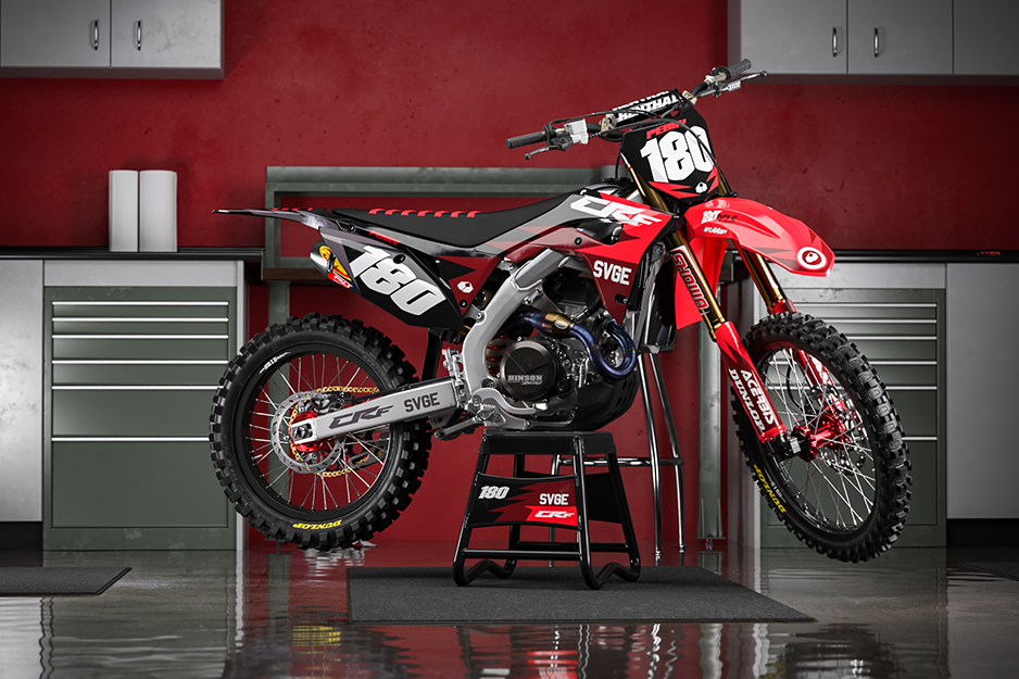 Motocross bike with red and white graphics and racing number 180