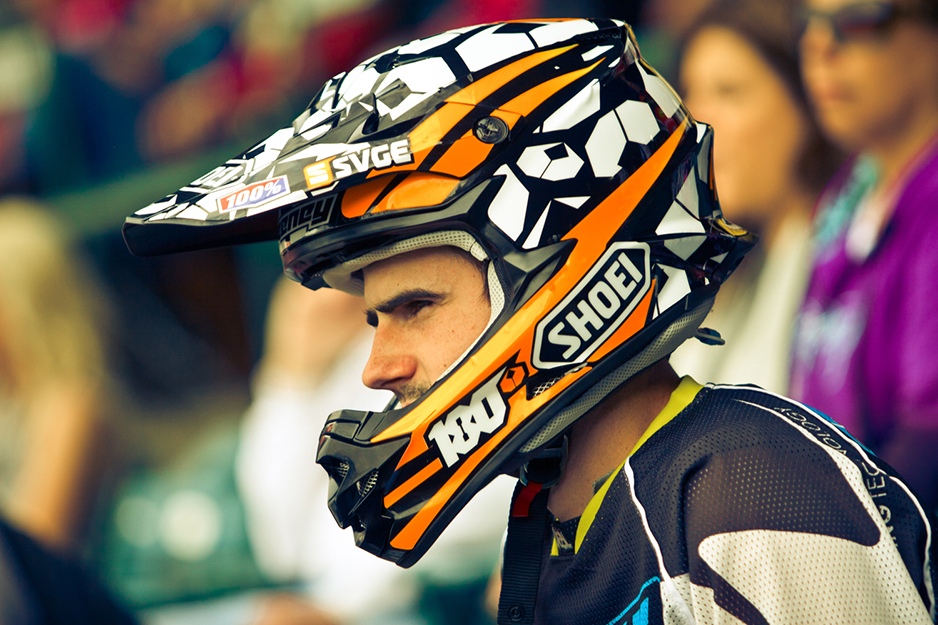 Motocross helmet with orange, black and white graphic