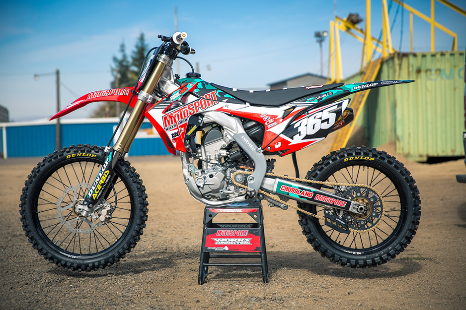 Motocross bike with red and white graphics