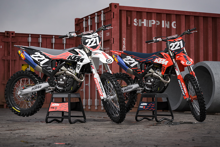 Two motocross racing bikes with colorful graphics