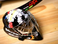 hockey stick and goalie mask