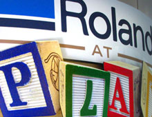 sectional sign Roland At Play